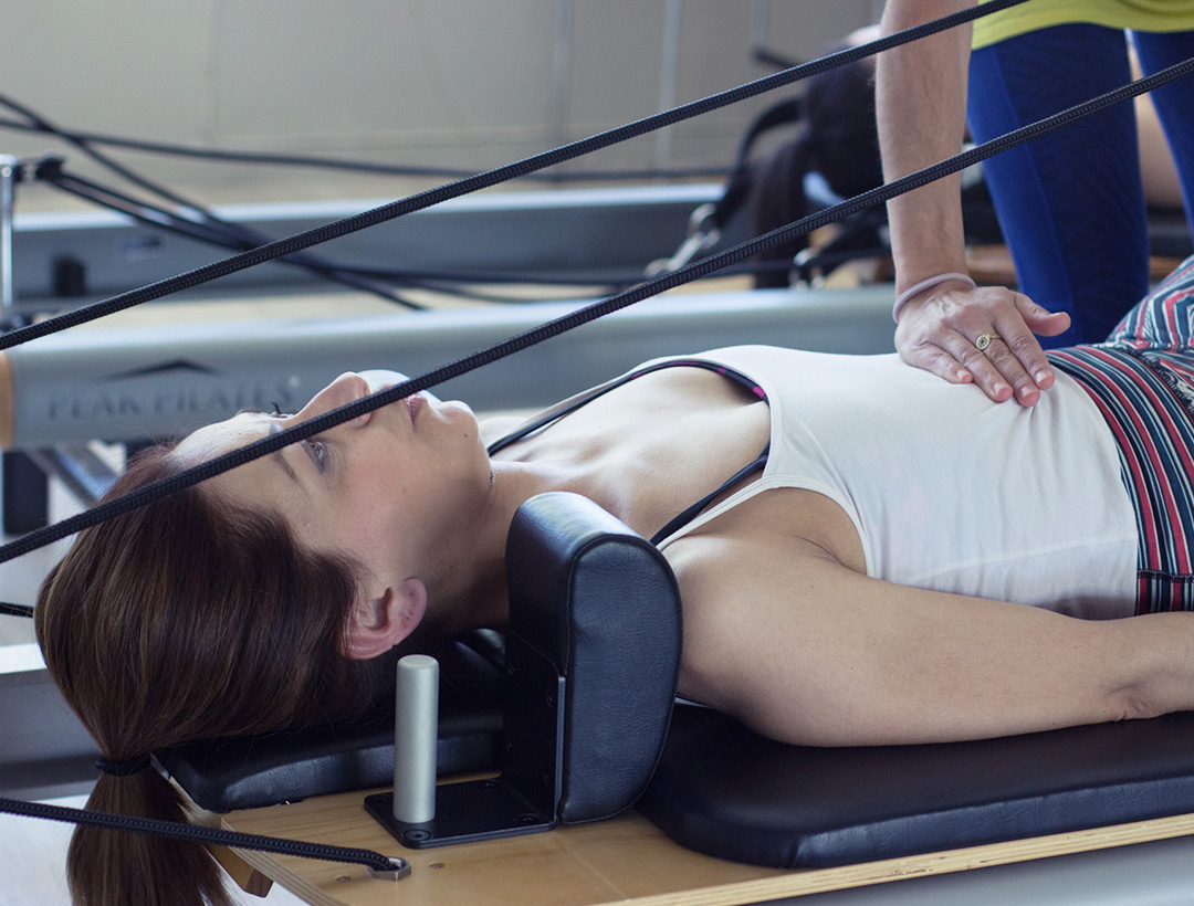 Student doing Pilates with equipment